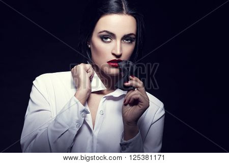 Sexyl woman bite tux at night sensuality and desire