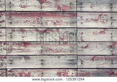 Old wooden planks texture with weathered red paint
