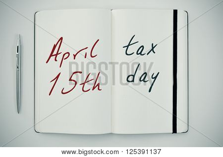 high-angle shot of an open notepad with the text april 15th tax day written in it, placed on a white table next to a pen, with a slight vignette added