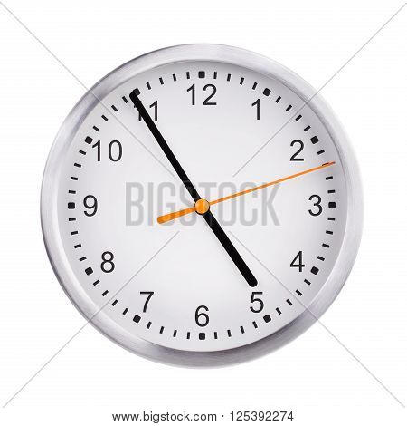 Large office round clock shows almost five hours