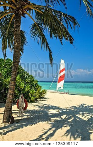 Nice beach with yacht in the tropical hotel Palm Beach Maldives The Indian Ocean