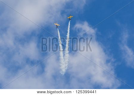 Minsk Belarus-June 21 2014: Acrobatic Stunt Planes RUS of Aero L-159 ALCA on Air During Aviation Sport Event Dedicated to the 80th Anniversary of DOSAAF Foundation in Minsk on June 21 2014 in Minsk Republic of Belarus