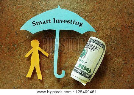 Paper man under a Smart Investing umbrella
