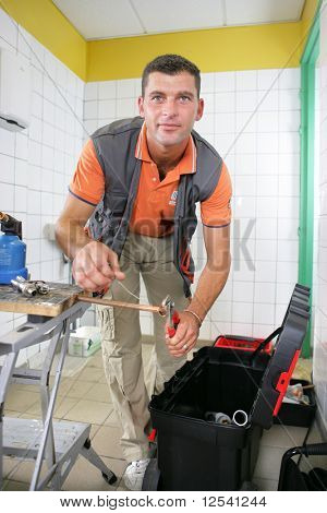 Man using a combination pliers