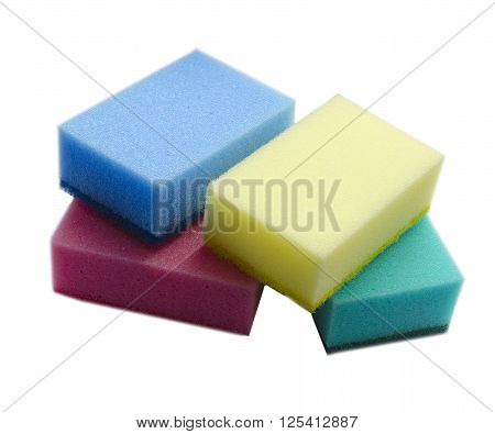 multi colored sponges on white background .