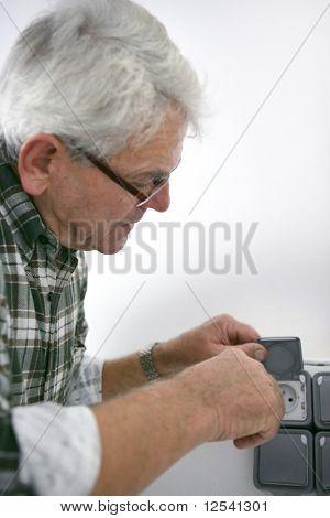Portrait of a man installing a socket