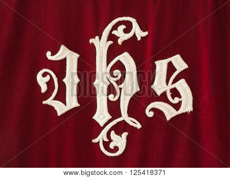 Detail view of Christogram lettering on cloth.