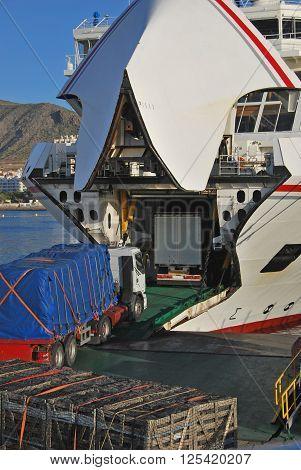 Big trucks loading on ferry shipboat. Cargo and logistics business
