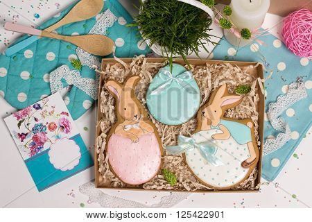 family holiday present box with gift card nice sweet trendy easter rabbits honey-cake on blue style kithen table with a lot of beautiful details