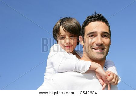 Portrait of a little boy and a man