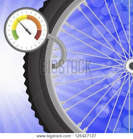 Manometer and Part of Bicycle Wheel on Bllurred Bllue Rays Background. Measuring Pressure in the Wheel.