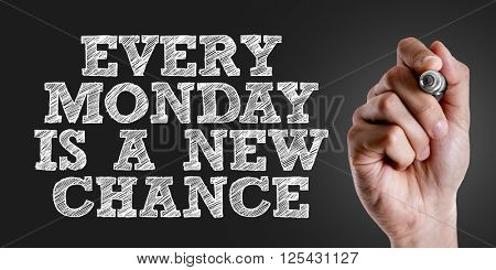 Hand writing the text: Every Monday Is a New Chance