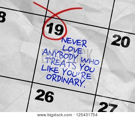 Concept image of a Calendar with the text: Never Love Anybody Who Treats You Like You're Ordinary.