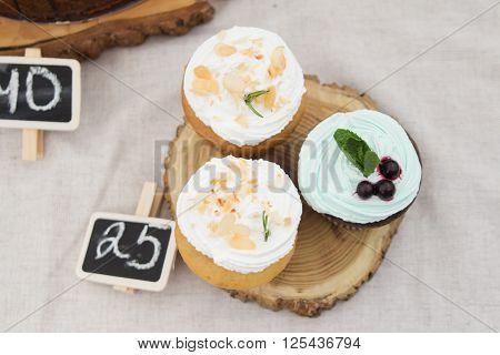 three of spongecake or muffin with cream