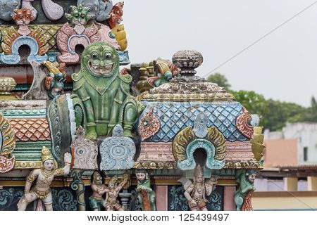 Trichy India - October 15 2013: Closeup of green monster statue on Gopuram at Shrirangam temple. Often associated with Makara the Hindu sea monster. The beast guards sanctuaries and is associated with Vishnu.