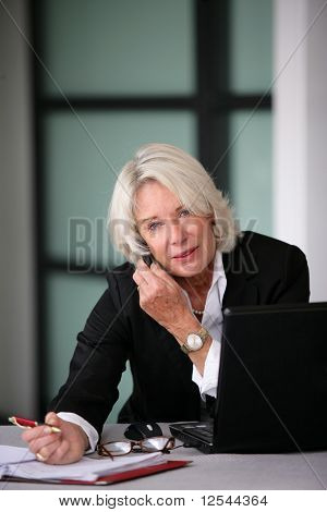 Portrait of a senior businesswoman phoning
