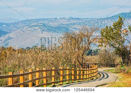 Fenced path to walk in the park. Hula Nature Reserve, Israel, December. Lake Hula is a wintering place for migratory birds
