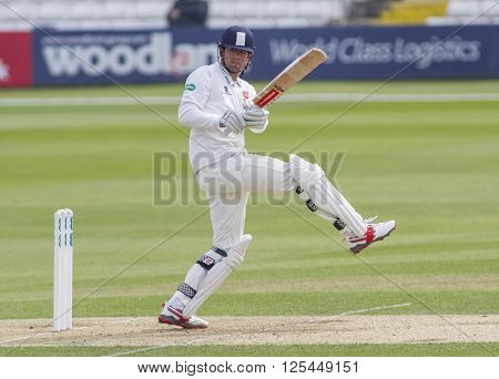 CHELMSFORD, ENGLAND - APRIL 11 2016: Alastair Cook of Essex hits the ball for four runs during the Specsavers County Championship match between Essex and Gloucestershire at the County Ground