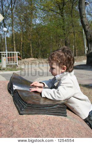 Small Boy Reading Big Book