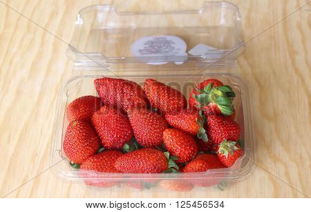 red and juicy strawberries packed for export, first quality poster
