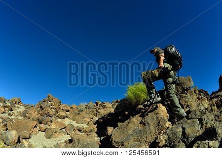 wildlife photographer outdoor in summer in Tiede crater, Tenerife, Spain