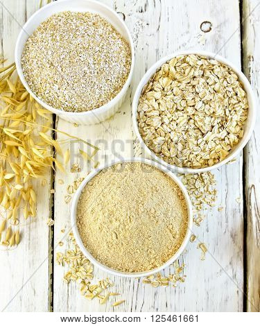 Flour Oat In White Bowl With Bran And Flakes On Board Top
