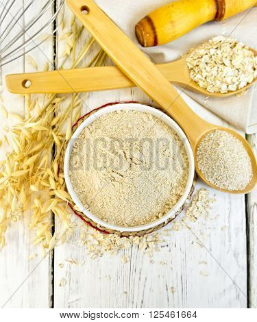 Flour Oat In White Bowl With Bran And Flakes On Light Board