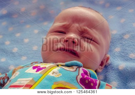 Bright photo of crying three month old baby boy