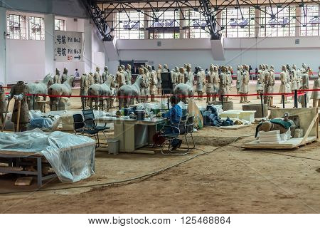 Xian China - October 16 2013: Research and restoration of the Terra-cotta Warriors near Xian in China.