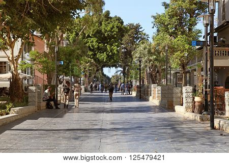 TEL AVIV, ISRAEL - APRIL 7, 2016 : People in open air commercial center Sarona in Tel Aviv, Israel. Recently open Sarona Market became the most popular place in Tel Aviv.