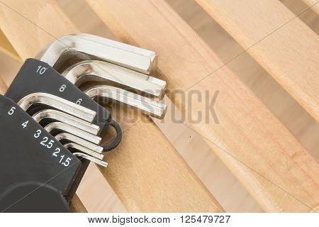 hex key hexahedron set on wood background