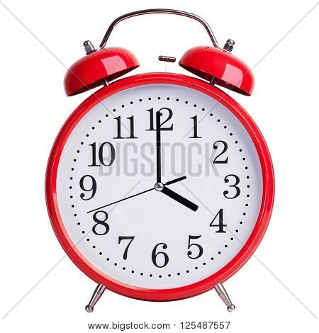 Round red alarm clock shows exactly four