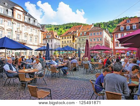 HEIDELBERG GERMANY - MAY 5 2013: Marketplace crowded with tourists and Town Hall in Heidelberg in Germany. Heidelberg is a city in Baden-Wurttemberg in Germany.