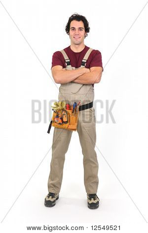 Workman in overalls with arms crossed on white background