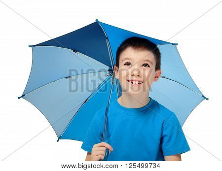Happy boy with blue umbrella looking up, isolated on white background