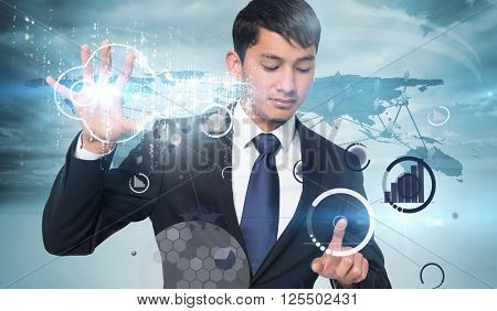 Unsmiling businessman holding and pointing against view of a global map