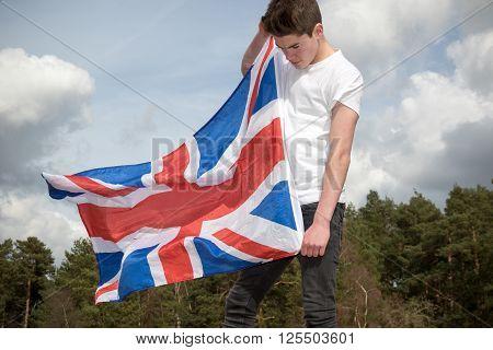Teenage boy holding a Union Jack, British Flag