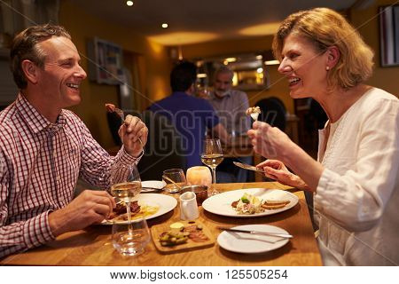 Senior couple having a meal together at a restaurant