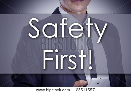 Safety First! - Young Businessman With Text - Business Concept