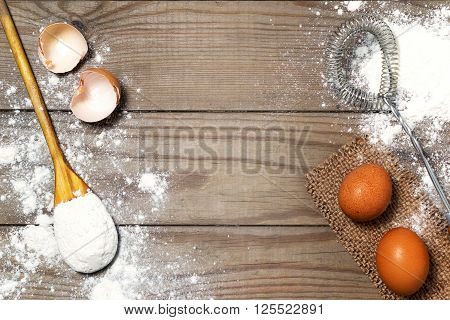 Eggs, Flour On The Wooden Table. Retro Whisk.