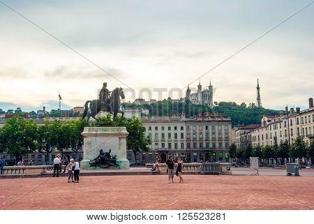 People Walking Along Main Square Of Lyon