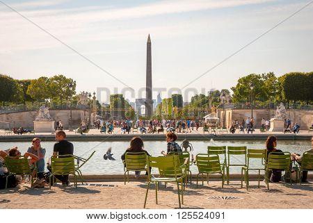 People Relaxing In Garden Of Tuileries