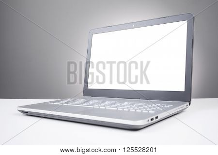 Laptop with blank screen on the table