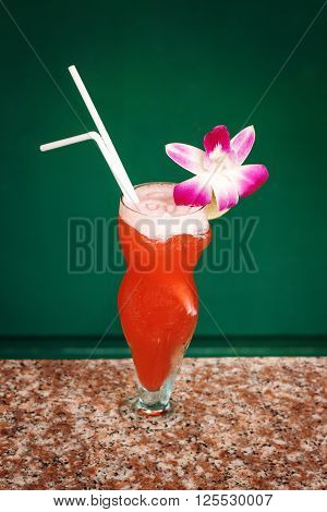 Tropical Red Cocktail With Orchid