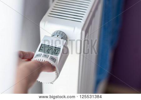Woman's Hand Adjusting Temperature