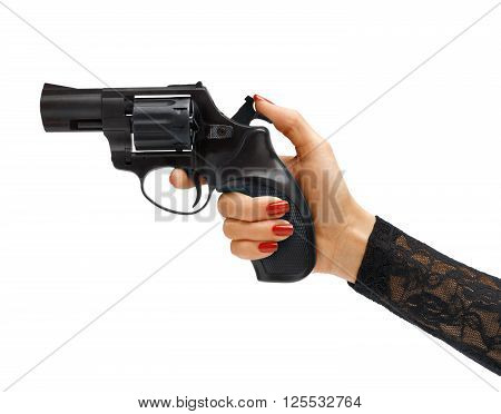 Woman's hand cocking revolver gun. Studio photography of woman's hand holding handgun - isolated on white background. Business concept