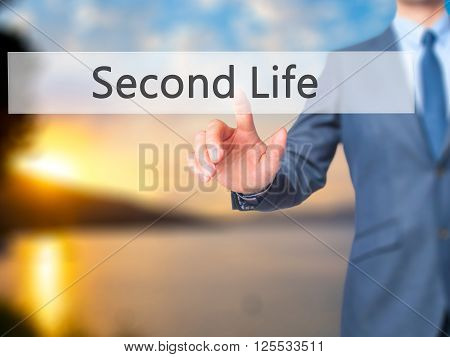 Second Life - Businessman Hand Pressing Button On Touch Screen Interface.