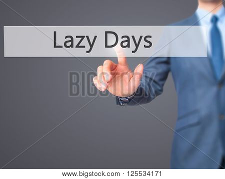 Lazy Days - Businessman Hand Pressing Button On Touch Screen Interface.