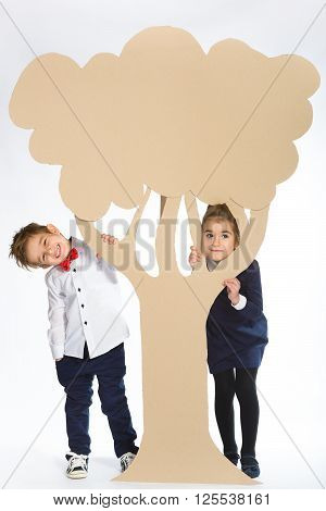 Love concept. Couple of kids. boy and girl with  cardboard flowers.