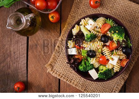 Pasta Salad With Tomato, Broccoli, Black Olives,  And Cheese Feta. Top View